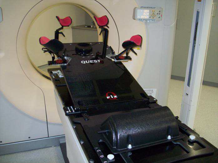 Showing 'the breast board' positioned on the CT Planning Scanner bed